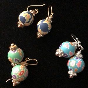 Clay resin earrings in colorful patterns on wires.